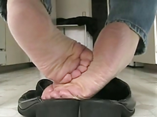 Under the table in the kitchen, bare soles