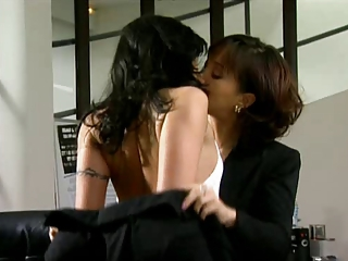 two brunettes lesbian attraction in office