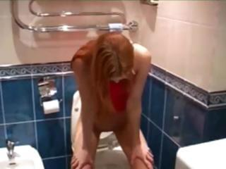 hot brunet pissing on toilet