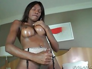 Sucking her heavy black balls until she cums tubes