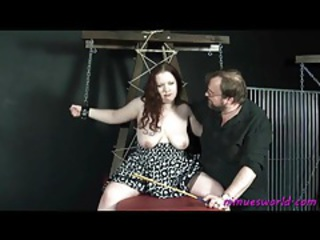 Chained up fat chick in a dress suffers tubes