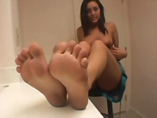 Brunette shows off her body and gives a foot job before getting nailed by an old guy