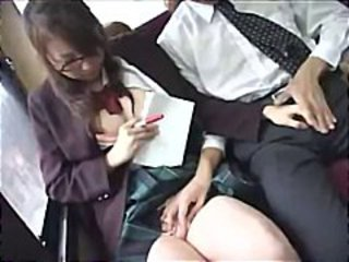 Schoolgirl on a bus is played with and forced to give a handjob