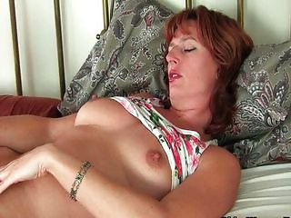 Mature masturbates with sex toys