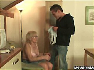 Mature blonde is being teased and played with by younger guy