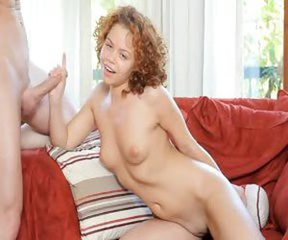 Redhead babe copulated on the red couch