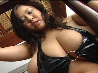 Giant tits Asian Fuko posing in black leather lingerie her monster natural boobs