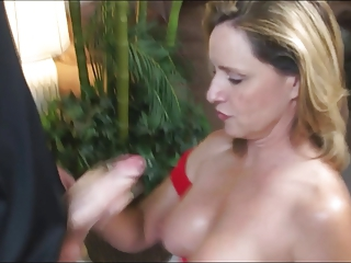 Milf with nice tits strokes a young cock