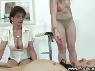 Two Prodommes Jerk Off Their Bound Slave