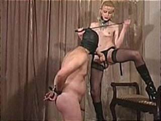 Blonde mistress Karin Von Kroft makes her slave suck her strapon and gives him a strapon fuck