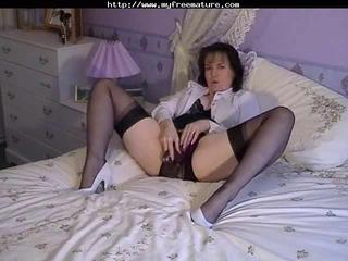 Solo brunette in nylon plays with her pussy
