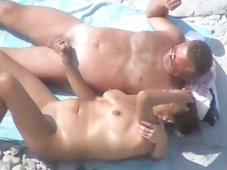various nice cougar couple on the shore