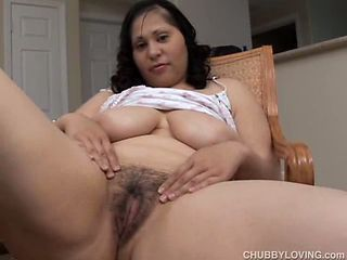 Pretty plumper plays with her bushy cunt