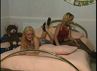 British lesbian threesome on the bed