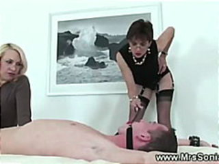Mistress instructing apprentice on how to rule a cock