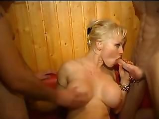 Nice looking blonde bitch takes a couple of cocks deep inside