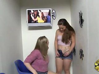 Two babes taking black cock at gloryhole