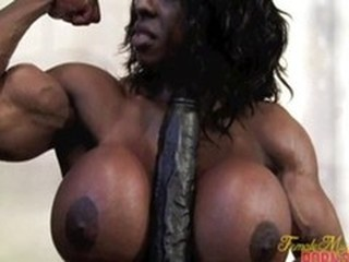 Black Bodybuilder playing with dildo