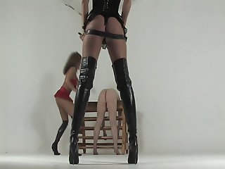 Kayla and Michelle whipping her slave