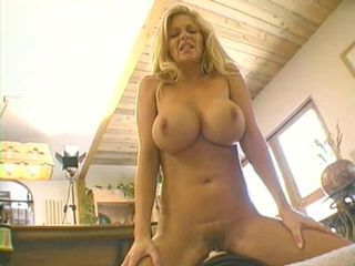 Big breasted blond screams on the sybian