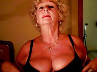 Granny Andrea shows her juicy tits
