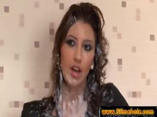 Tall brunette gets messy facial at the gloryhole