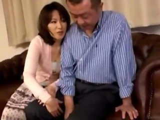 Milf Giving Blowjob For Her Husband Cum To Hand On The Couch In The Sitting Room