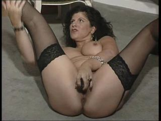 British slut Gilly plays with...