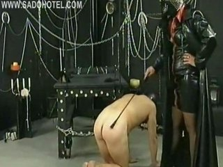 Dirty masked slave with metal clamps on her nipples got spanked and his cock and balls played by horny dominatrix