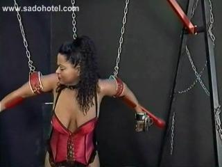 Two Scared Slaves Tied With Their Arms And Head In A...