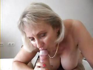 Busty Blonde Mature Babe Is Giving Him A Nice Pov Blowjob