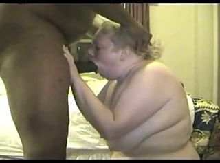 Submissive white fat sucks black cock