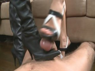2 babes milking a cock with their shoes and boots