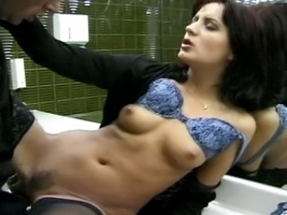 A quickie in a public restroom turns into a hard steamy fucking with a huge...