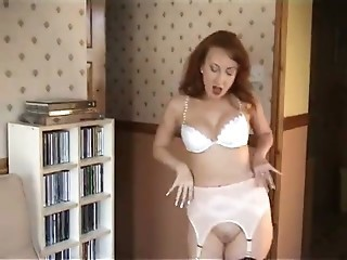 British slut Red plays with herself in stockings