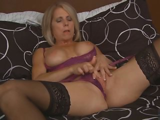 Blond milf masturbates in black stockings