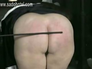 Bend over nun is spanked on her ass and hands with a wooden stick by priest