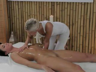 Blonde lesbian masseuse seduces a brunette customer Sex Tubes