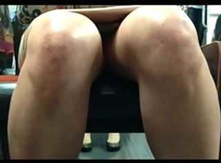 Legs and upskirt in train 26