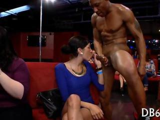 Party girls polish a black strippers knob