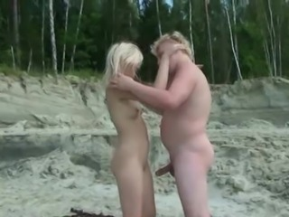 Plump boy seduces a blond hottie by the river