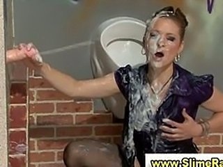 Glamorous clothed babe gets facial from gloyhole