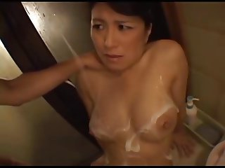 Japanese mother and not her son in the bathroom