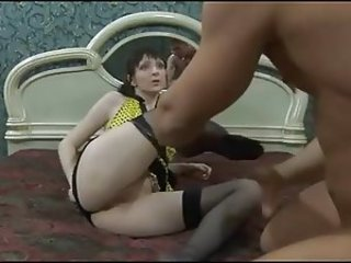 A guy with a mature woman breaking her ass