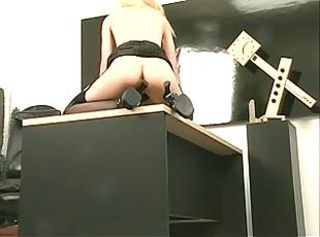 Sexy skinny blonde strips and plays with a dildo at the office