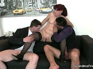 Office bitch enjoys two cocks and gets a pussy lick