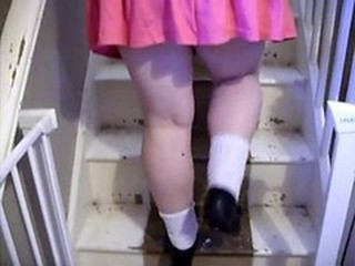 My wife teasing on the stairs