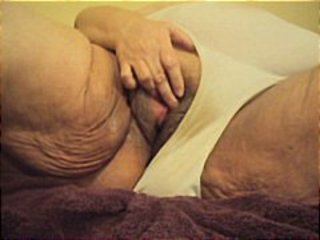 Really fat lady is rubbing her big pussy in this POV clip