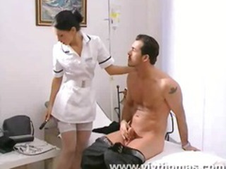 Busty Brunette Doctor Gives A Bodycheck
