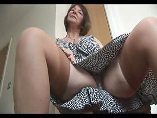 Busty mature brunette does a little...